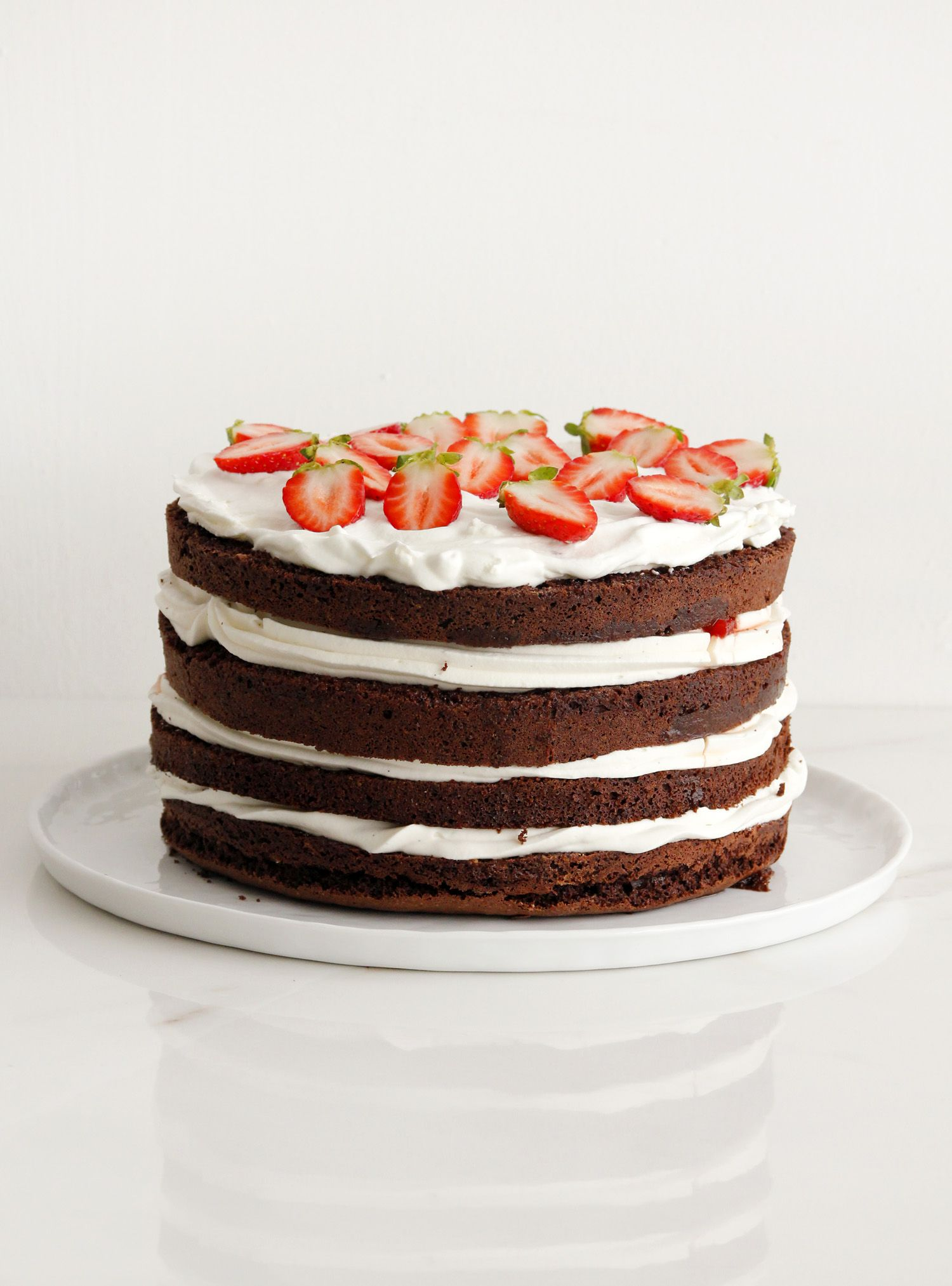 Sky-high Chocolate, Cream and Strawberry Layer Cake